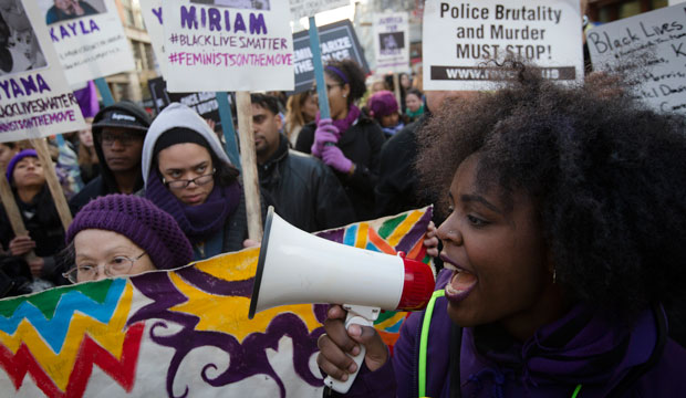 Demonstrators march in New York on December 13, 2014, during the Justice for All rally and march.