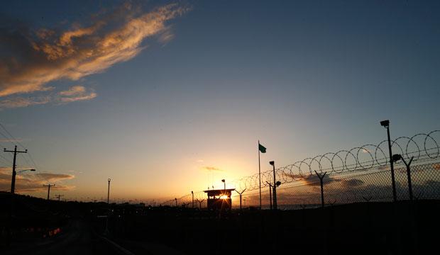 The sun rises above Camp Delta at Guantanamo Bay Naval Base, Cuba, November 2013.