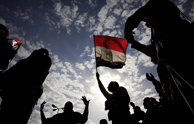 Protesters chant as they wave Egyptian flags during their protest in Cairo, Egypt, February 6, 2011.