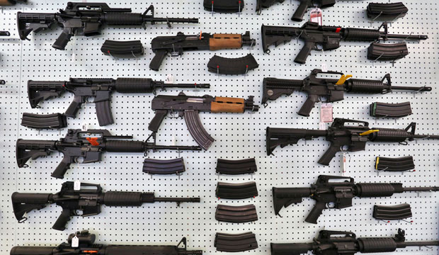 Guns are displayed for sale at an arms seller in Colorado, July 2014.