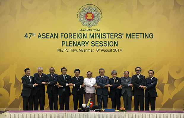 Foreign ministers of the Association of Southeast Asian Nations pose for a group photo before commencing the plenary session of the 47th ASEAN Foreign Ministers meeting in Nay Pyi Taw, Myanmar, August 8, 2014.