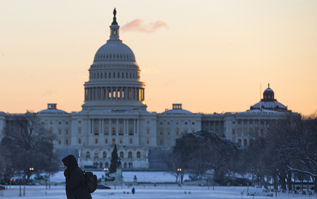 The U.S. Capitol building is seen after a snowstorm in Washington, January 3, 2014.