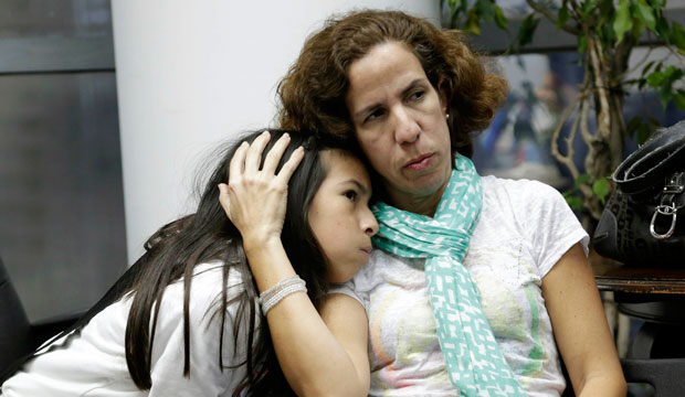 Isabella Roseta sits with her daughter Vanessa during a Florida Immigrant Coalition meeting about President Obama's executive order on immigration.