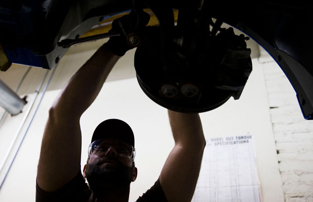 An automotive service technology student works on a car at the Community College of Philadelphia.