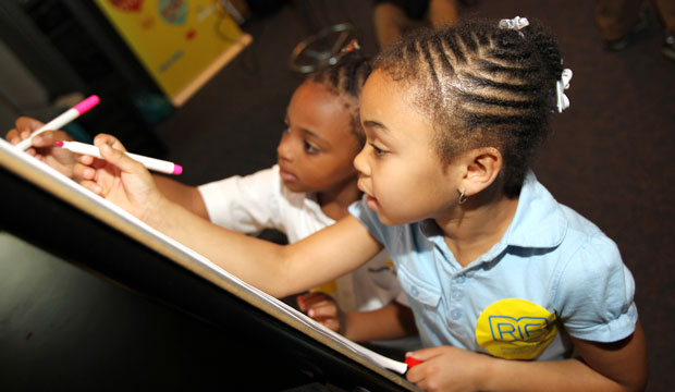Children learn about illustration and storytelling at Joint Base Andrews in Prince George's County, Maryland.