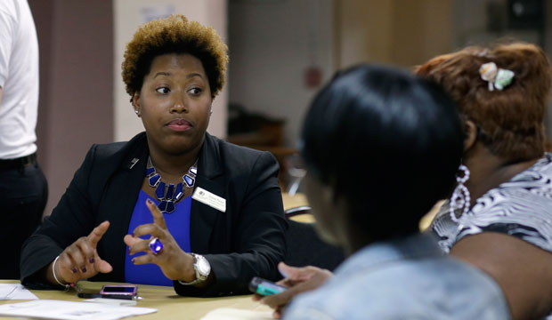 Natalie Parker talks with applicants during a job fair at the Hospitality Institute.
