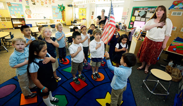 Children in a prekindergarten class recite the pledge of allegiance at the start of the school day in Tacoma, Washington.