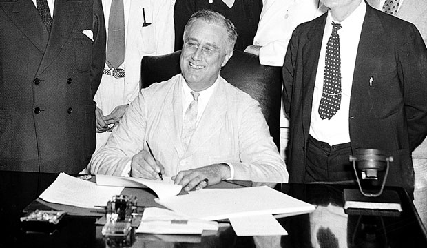 President Franklin D. Roosevelt signs the Social Security Act in Washington, D.C., on August 14, 1935.