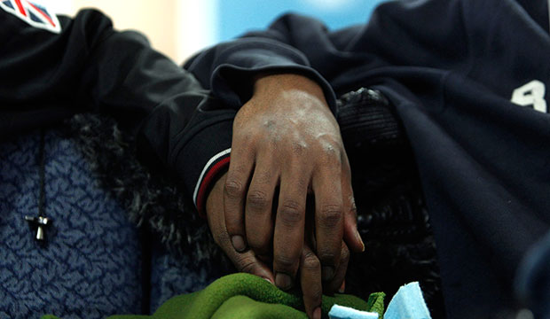 Two boys hold hands at the Ruth Ellis Center, a drop-in shelter for LGBT youth in Detroit, March 2012.