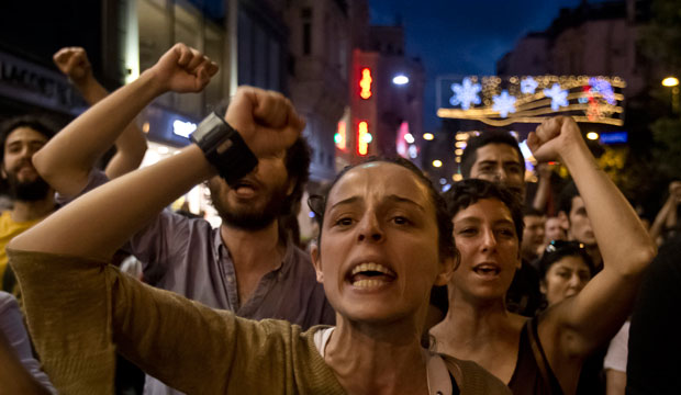 People chant slogans as they try to reach Gezi Park in Istanbul, Turkey, in July 2013.