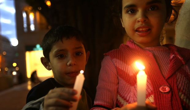 Children hold candles during a vigil in downtown Beirut, Lebanon, on March 1, 2015, held in solidarity with Christians abducted in Syria and Iraq.