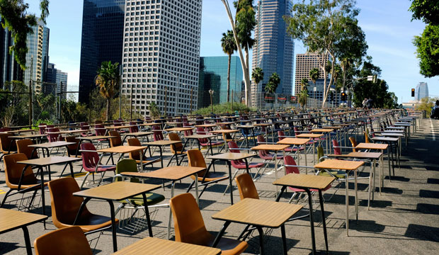 School desks block a street in front of the Los Angeles Unified School District headquarters in a demonstration against student dropout rates on April 8, 2014, in downtown Los Angeles.