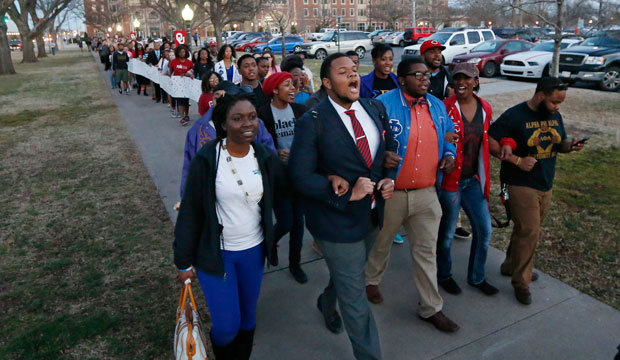 University of Oklahoma students march to the now-closed Sigma Alpha Epsilon fraternity house during a rally on March 10, 2015.