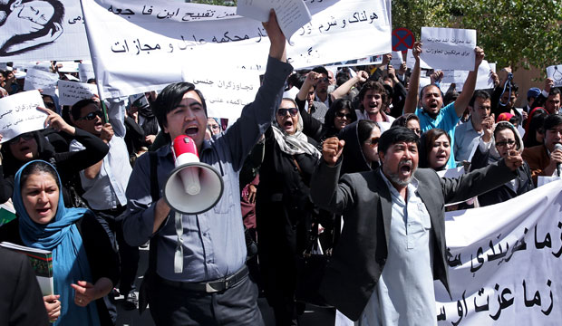 Civil-society activists in Kabul, Afghanistan, chant slogans during a September 2014 rally.