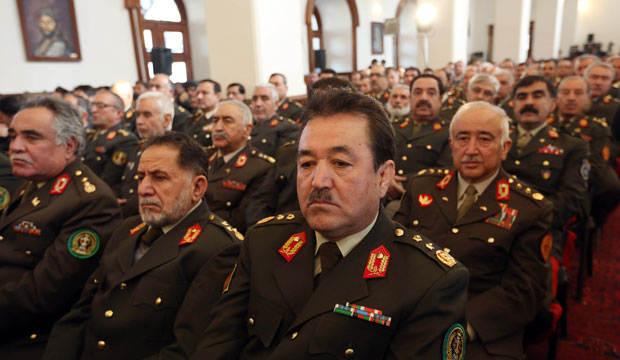 Afghan security officers listen to a speech by President Ashraf Ghani.