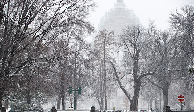 Snow falls on Capitol Hill in Washington, March 5, 2015.