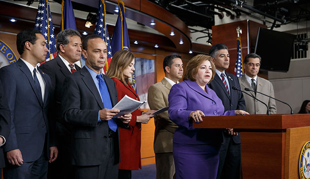 Members of the Congressional Hispanic Caucus hold a news conference to discuss their efforts to implement President Barack Obama's immigration executive action on the expansion rollout of the Deferred Action for Childhood Arrivals program, February 13, 2015, on Capitol Hill in Washington.