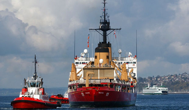 U.S. Coast Guard Cutter Polar Sea is towed stern-first into the Port of Seattle for major engine repairs, March 2004.