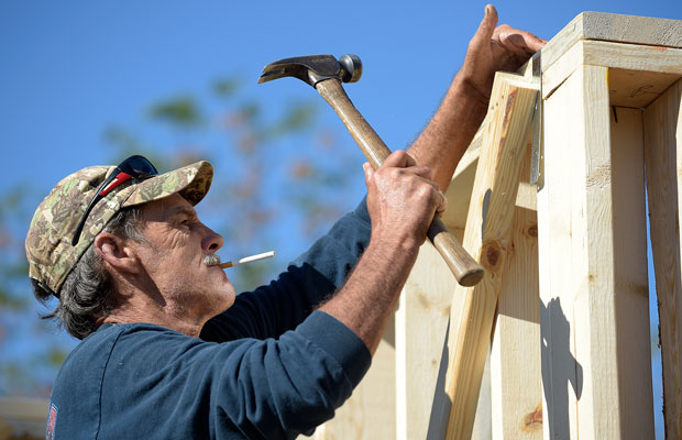 Construction worker David Rager frames the upper floor of a two-story custom home being built in Orlando, Florida, February 13, 2015.