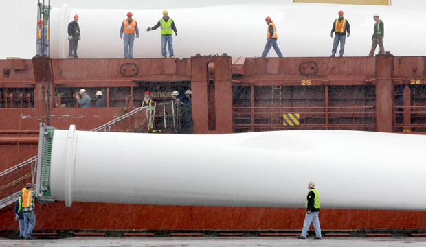 Workers unload one of three blades from a giant wind turbine on Monday, April 25, 2011, at the Port of Cleveland.