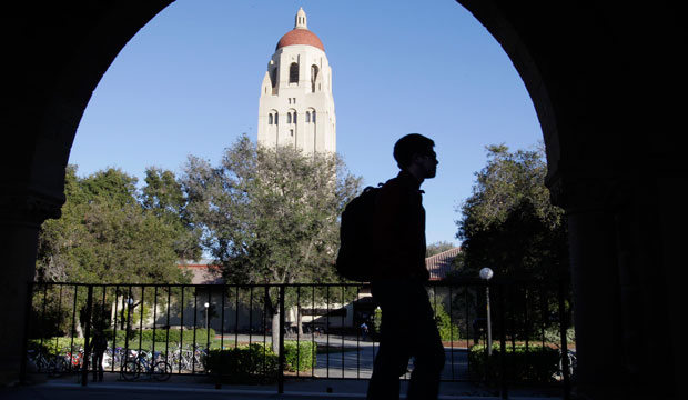 A Stanford University student walks in front of Hoover Tower on the Stanford University campus, 2012.