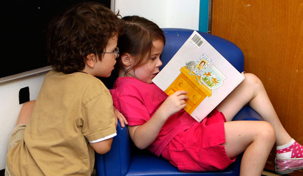 Pre-K students read a book at the Walden Early Childhood Center at Emory University in Atlanta, Georgia.