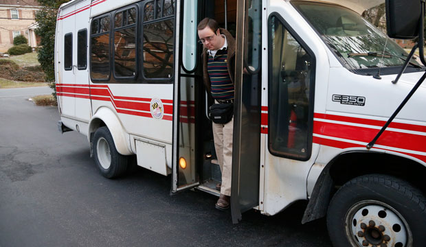 Matthew McMeekin gets off a bus at his home in Bethesda, Maryland, as he returns from work on February 10, 2014.