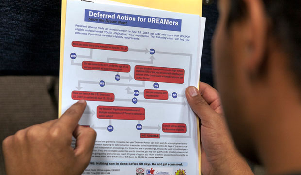 A legal immigrant reads a guide of the conditions needed to apply for the Deferred Action for Childhood Arrivals, or DACA, program.