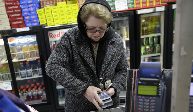 Hilda Herrera pays for her groceries using a nutrition assistance program at a supermarket in West New York, New Jersey.