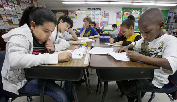 Third-grade students do school work during class at Hanby Elementary School in Mesquite, Texas, February 2011.