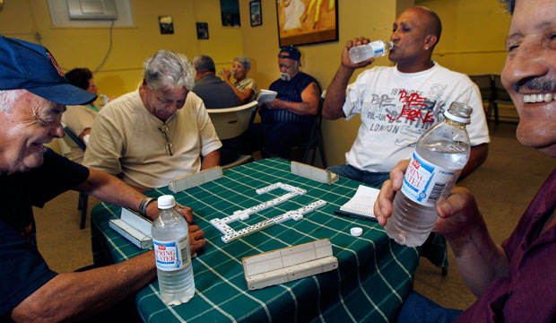 Residents play dominos at the Riverview Senior Center in Springfield, Massachusetts, a designated cooling center for people seeking relief from the hot weather, on June 9, 2011.