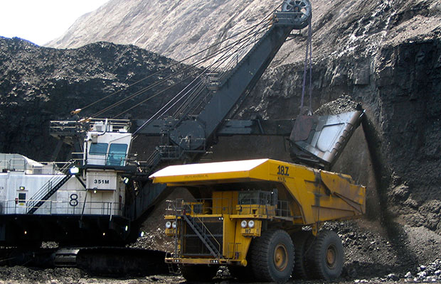 A shovel prepares to dump a load of coal into a 320-ton truck at the Black Thunder Mine in Wright, Wyoming, April 2007. Black Thunder Mine is located in the state's Powder River Basin.