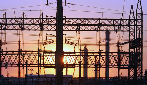 The sun sets behind an electrical power substation in Elizabeth, New Jersey, August 23, 2005.
