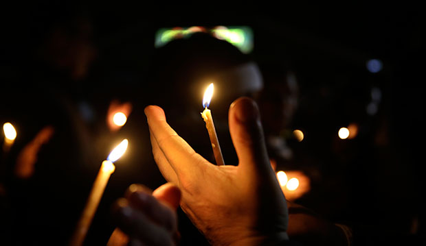 People take part in a candlelight vigil in Ferguson, Missouri, March 12, 2015.