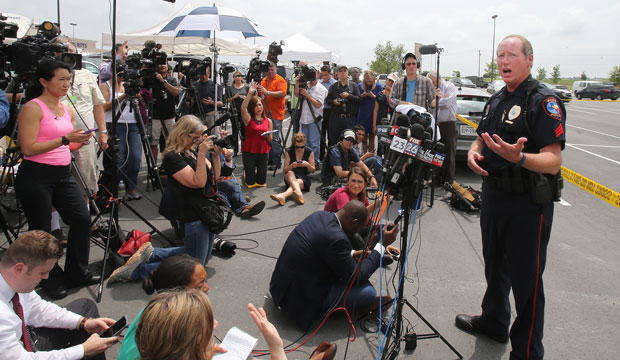 Waco Police Sgt. Patrick Swanton addresses the media as law enforcement continues to investigate the motorcycle gang related shooting on May 18, 2015, at the Twin Peaks restaurant in Waco, Texas.