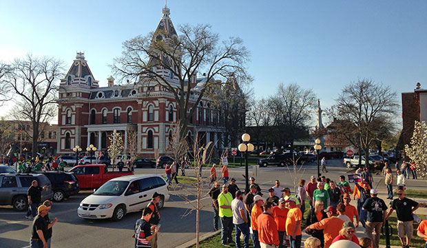 An overflow crowd of union members protest outside a Livingston County board meeting site in Pontiac, Illinois, April 16, 2015. The board was set to consider the governor's right-to-work efforts.