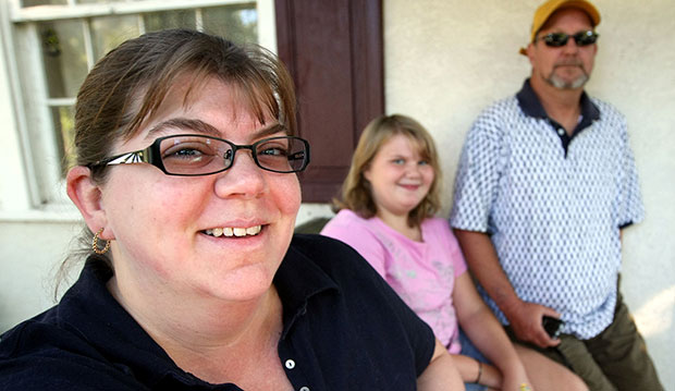 Working mother Sunita Clark, left, poses with her 10-year-old daughter Ruby, center, and husband Mark, September 2007, in Columbus, Ohio.