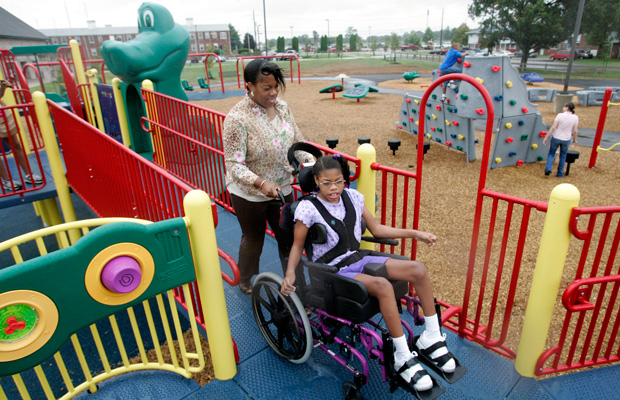 Melissa Nelson takes her daughter to the Boundless Playground at Fort Campbell, Kentucky. The playground is specially designed for both parents and children with disabilities.