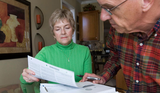 Judy and Bob Dienell review their financial statements, October 2008.