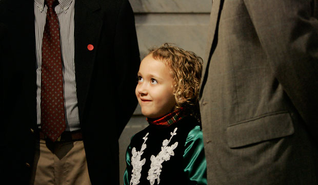 Seven-year-old Amber Harland-Bennett listens as her adoptive parents, Richard and Anthony Harland-Bennett, speak with reporters during a rally in Frankfort, Kentucky, in February 2009.