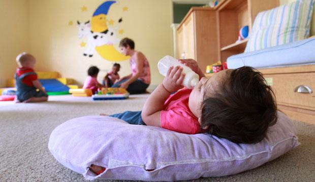 A toddler rests at the Sacramento Crisis Nurseries in Sacramento, California in April 2009.