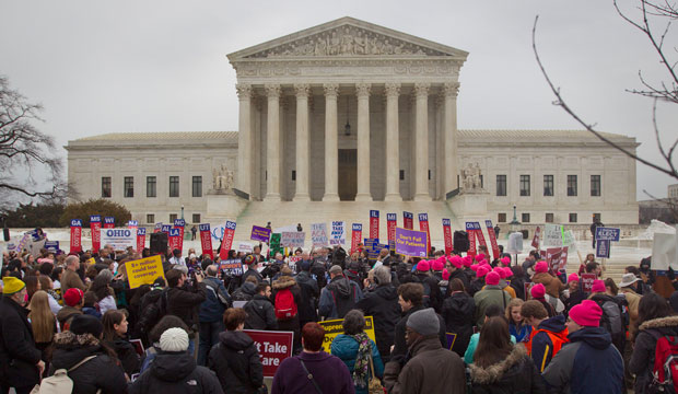 A crowd gathers outside the Supreme Court on March 4, 2015, as the Court hears arguments in <i>King v. Burwell</i>.