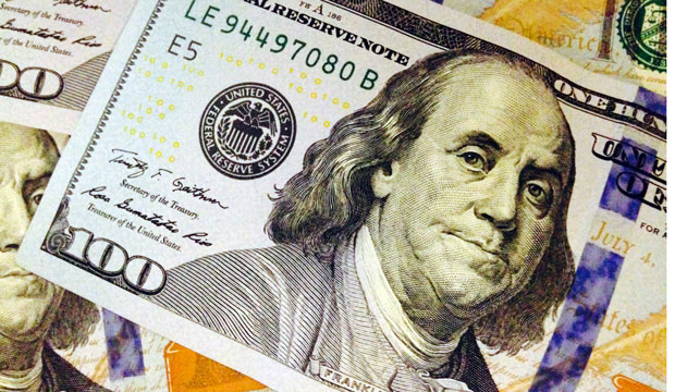 This February 2, 2015, photo depicts a part of a $100 bill.