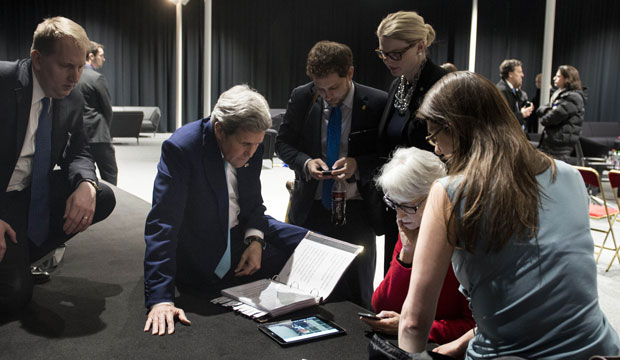 U.S. Secretary of State John Kerry watches President Barack Obama speak via tablet in Lausanne, Switzerland, on April 2, 2015, after Iran nuclear program talks finished.