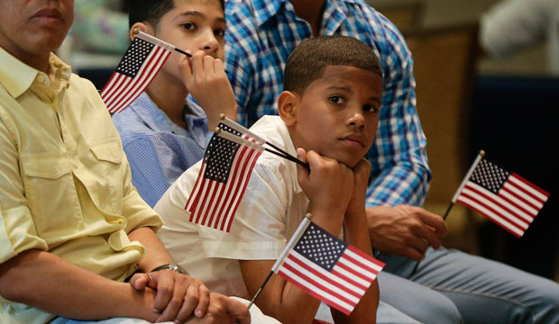 Derek Martinez listens during a citizenship ceremony in New York on May 26, 2015.