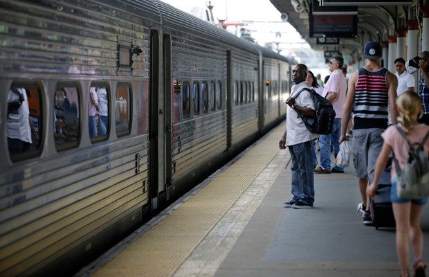 People wait to board a train to New York City at the Trenton train station in Trenton, New Jersey, July 2014.