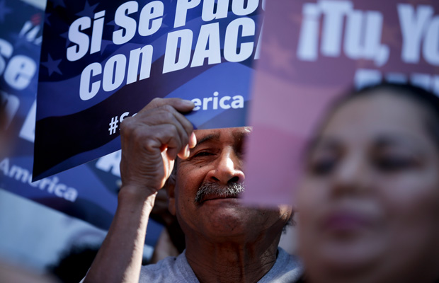 A man stands among signs during a rally in San Diego in support of immigration reform.