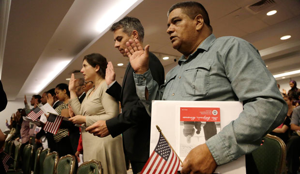 New U.S. citizens recite the Oath of Allegiance while participating in a naturalization ceremony, New York, July 2014.
