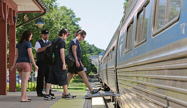 Passengers board an Amtrak train at a station in Exeter, New Hampshire, July 2012.