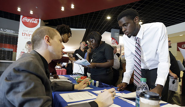 A jobseeker listens to an employer during a job fair in Sunrise, Florida, June 2015.